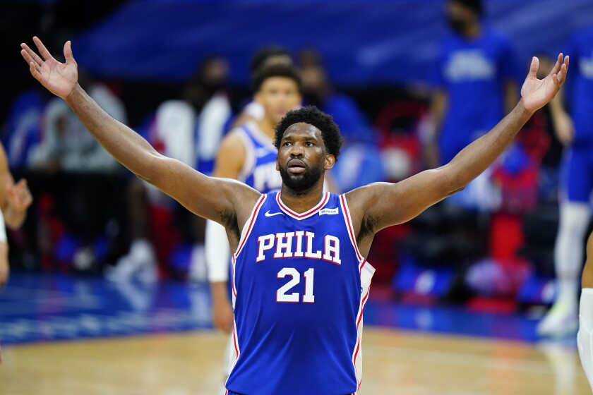 The 76ers' Joel Embiid celebrates his 50-point performance game against the Bulls in Februrary.