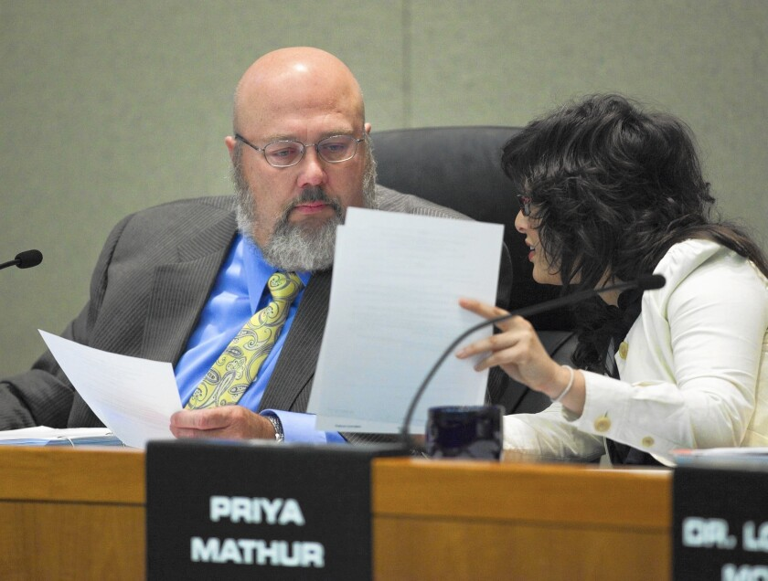 Rob Feckner, left, president of the CalPERS board of administration, presides over a 2009 meeting at CalPERS headquarters in Sacramento. Board member Priya Mathur is on his right.