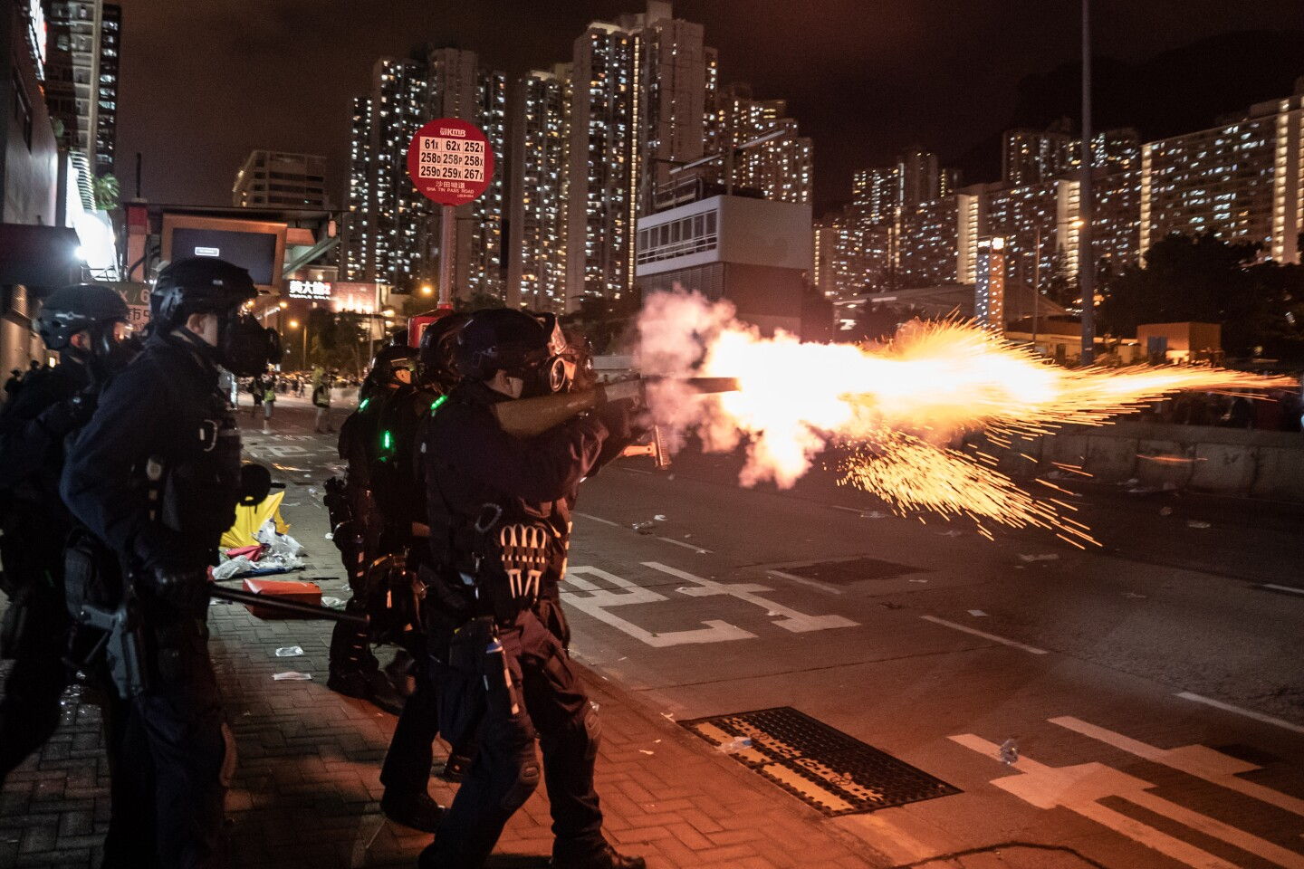 """HONG KONG, CHINA - AUGUST 5: Riot police fire tear gas at protesters during a demonstration in Wong Tai Sin District on August 5, 2019 in Hong Kong, China. Pro-democracy protesters have continued rallies on the streets of Hong Kong against a controversial extradition bill since 9 June as the city plunged into crisis after waves of demonstrations and several violent clashes. Hong Kong's Chief Executive Carrie Lam apologized for introducing the bill and declared it """"dead"""", however protesters have continued to draw large crowds with demands for Lam's resignation and completely withdraw the bill. (Photo by Anthony Kwan/Getty Images) ** OUTS - ELSENT, FPG, CM - OUTS * NM, PH, VA if sourced by CT, LA or MoD **"""