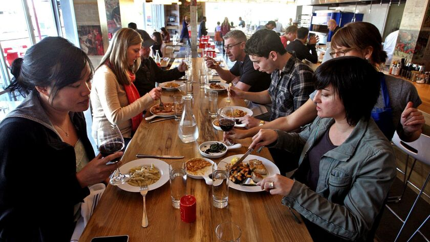 VENICE, CALIF. - FEBRUARY 11, 2013: Customers enjoy lunch at Hostaria del Piccolo in Venice on Febr