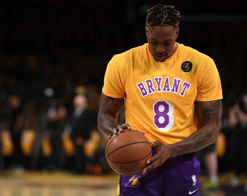 Dwight Howard wears a Kobe Bryant jersey over his warmups before a pregame ceremony Jan. 31 to honor the life of Kobe Bryant, who died in a helicopter crash with his daughter Gianna and seven others on Jan. 26r.