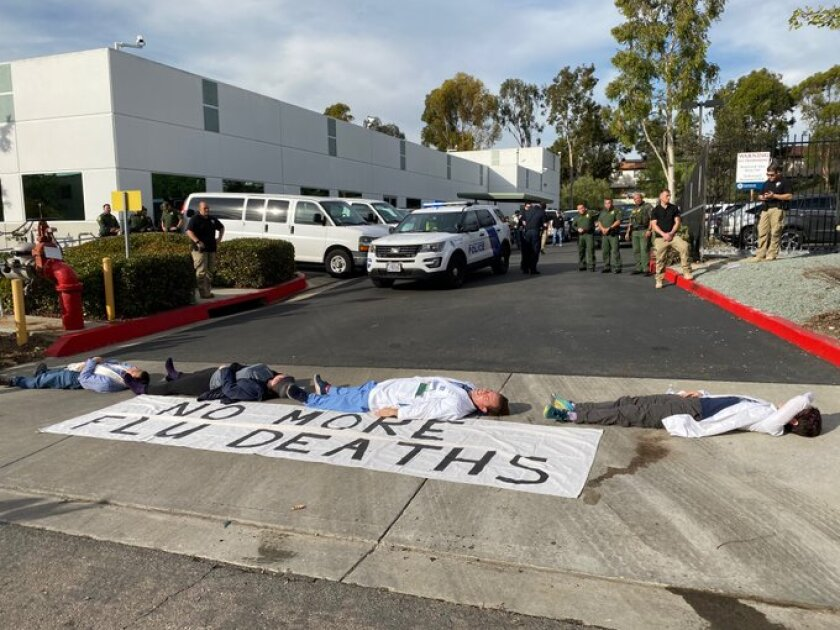 Doctors and other activists protest Tuesday outside the Border Patrol San Diego Sector headquarters in Chula Vista.