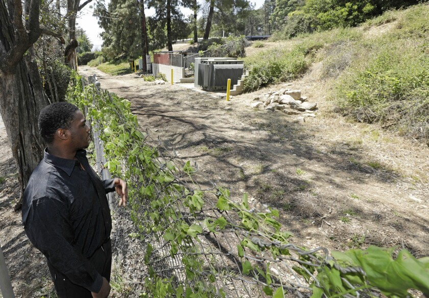 ALTADENA, CA-MAY 16, 2018: Matthew Whitaker, 20, looks at the spot (to the right of the pile of rock