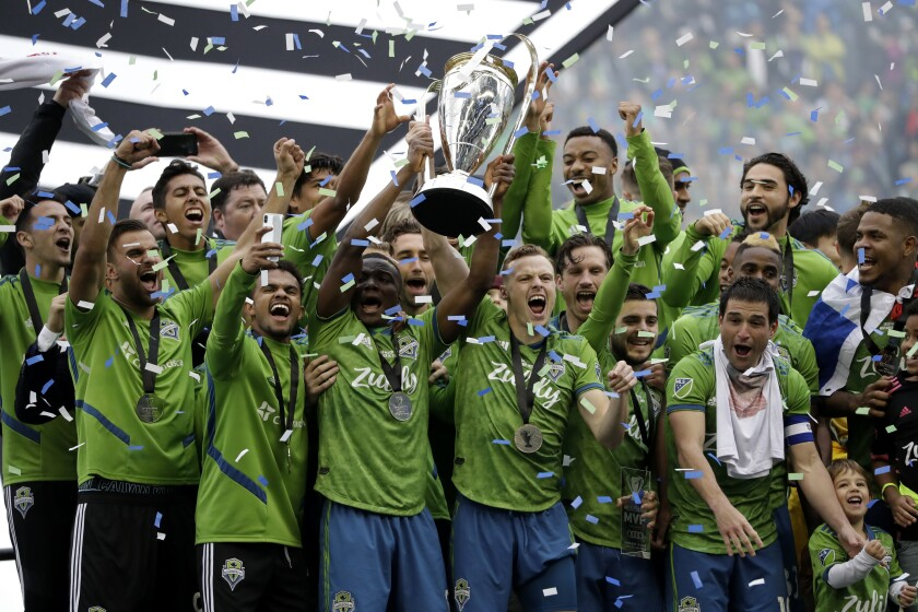FILE - In this Sunday, Nov. 10, 2019 file photo, Seattle Sounders celebrate after the team beat the Toronto FC in the MLS Cup championship soccer match in Seattle. The Seattle Sounders are known for making the Major League Soccer postseason in each year of the club's existence. The team has also shown the ability to correctly assess when it needs to overhaul its personnel, whether it's bringing in an influx of fresh talent or giving younger players in the system a chance. That's the decision the Sounders made going into the 2021 season. (AP Photo/Elaine Thompson, File)