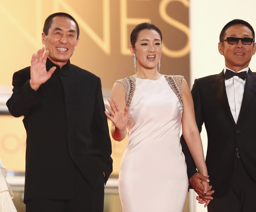 """Zhang Yimou, left, Chinese actress Gong Li and Chinese actor Chen Daoming at the """"Coming Home"""" premiere at Cannes."""
