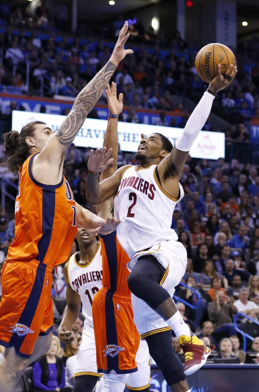 FILE - In this Sunday, Feb. 21, 2016, file photo, Cleveland Cavaliers guard Kyrie Irving (2) goes up for a basket in front of Oklahoma City Thunder center Steven Adams (12) defends during the first half of an NBA basketball game in Oklahoma City. Turns out, Irving didn't have a flu bug. He had bed bugs. The star guard says he left Cleveland's game against Oklahoma City because he felt nauseous and tired from lack of sleep after being bitten in his hotel room. (AP Photo/Alonzo Adams, File)