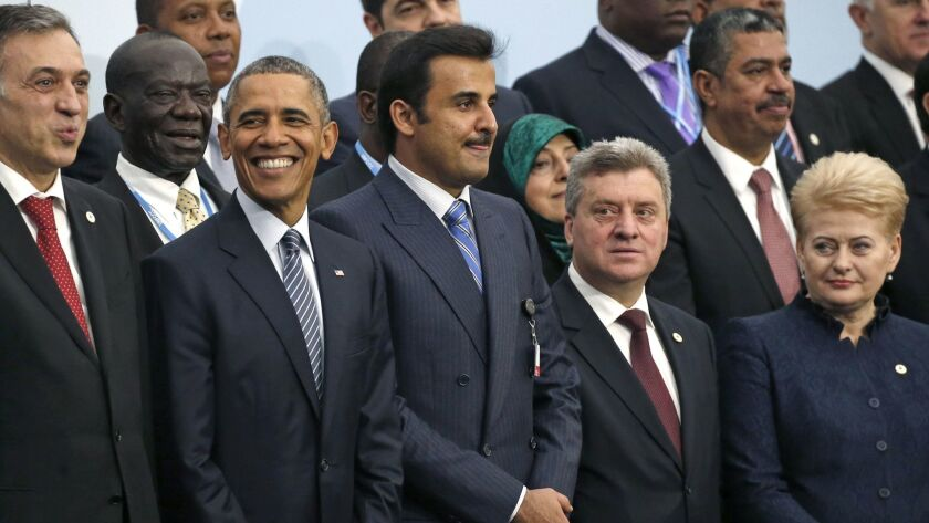 Then-U.S. President Barack Obama, posed with world leaders at United Nations Climate Change Conference, in Le Bourget, outside Paris on Nov. 30, 2015.