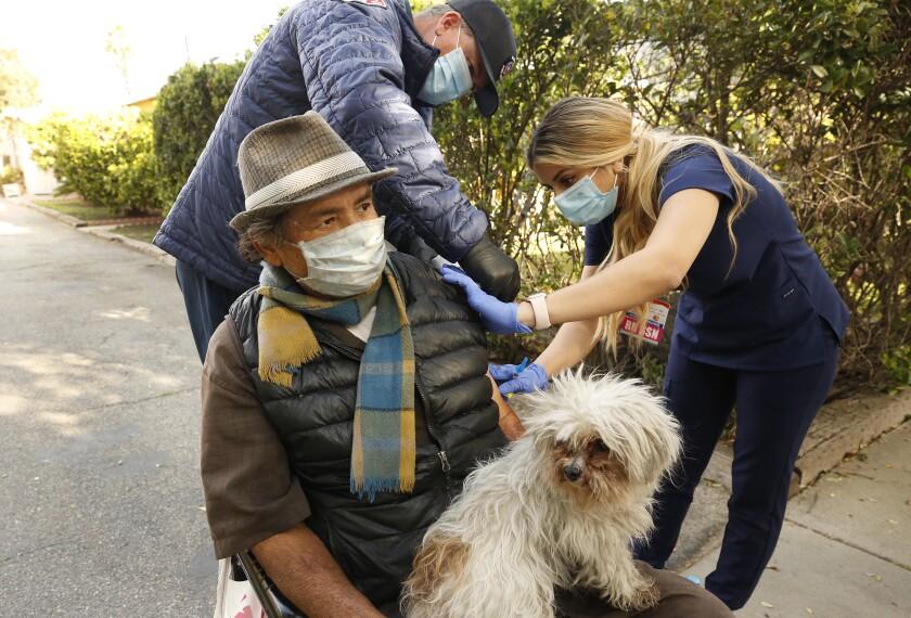 Nurse Bella Pashabezyan administers COVID-19 vaccine to Nelson Navarro in Glendale.