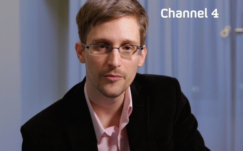 A handout picture from Britain's Channel 4 shows intelligence leaker Edward Snowden preparing to make his television Christmas message.