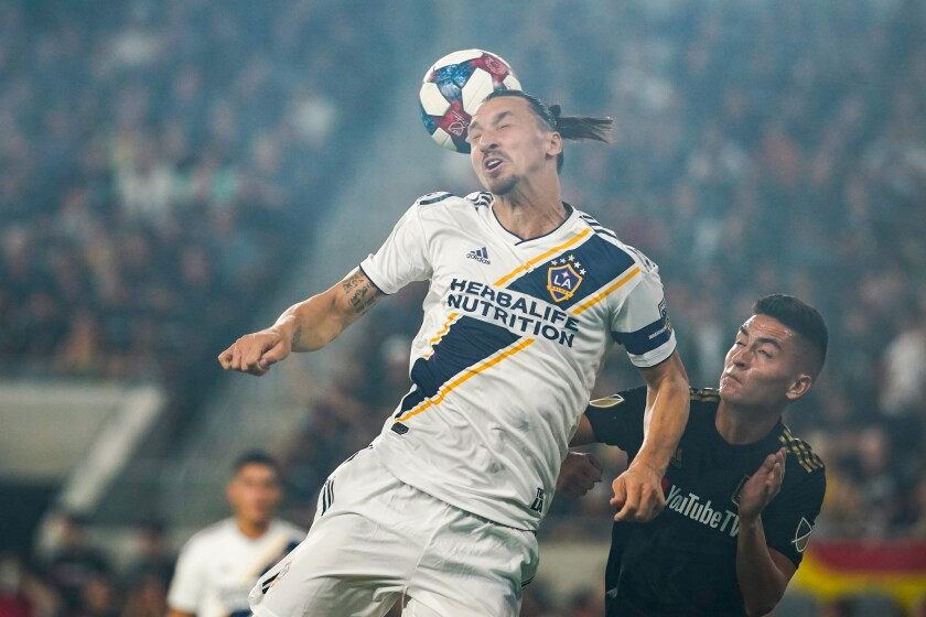 Galaxy forward Zlatan Ibrahimovic heads the ball during Thursday's 5-3 loss to LAFC in the MLS Western Conference semifinals.