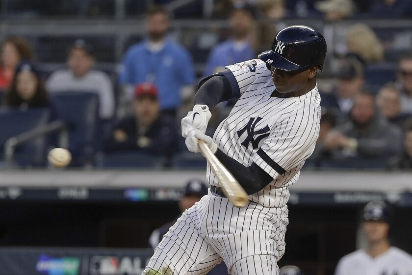 New York Yankees shortstop Didi Gregorius (18) connects for a grand slam home run against the Minnesota Twins during the third inning of Game 2 of an American League Division Series baseball game, Saturday, Oct. 5, 2019, in New York. (AP Photo/Frank Franklin II)