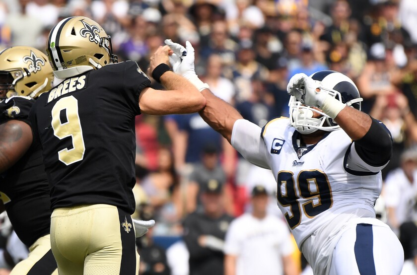 Rams defensive lineman Aaron Donald hits Saints quarterback Drew Brees' throwing hand.