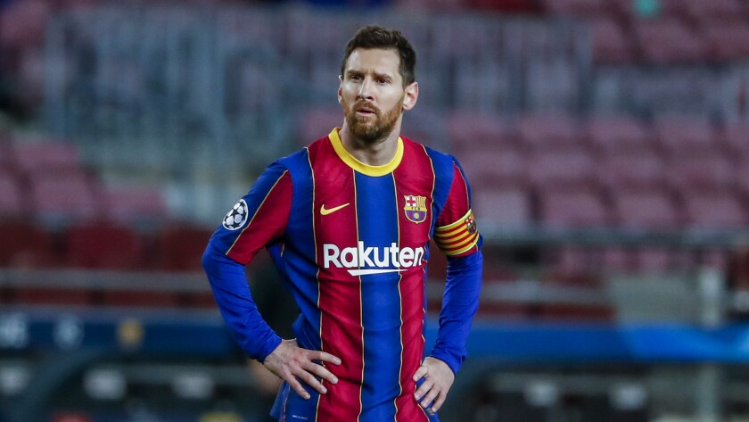 """FILE - In this Tuesday, Feb. 16, 2021 file photo, Barcelona's Lionel Messi looks on during their Champions League soccer match against Paris Saint-Germain at the Camp Nou stadium in Barcelona, Spain. Messi is set to play his 45th """"clasico"""" match against Real Madrid on Saturday, April 10 and it could be his last. Messi has said he will decide his future when his contract expires at the end of the season. (AP Photo/Joan Monfort, file)"""