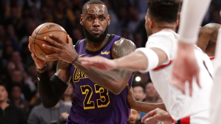 Lakers forward LeBron James looks for a way to the basket against the Portland Trail Blazers in the third quarter on Wednesday at Staples Center.