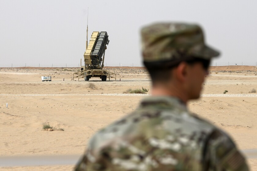 FILE - In this Feb. 20, 2020, file pool photo, a member of the U.S. Air Force stands near a Patriot missile battery at Prince Sultan Air Base in Saudi Arabia. The U.S. has removed its most advanced missile defense system and Patriot batteries from Saudi Arabia's Prince Sultan Air Base in recent weeks, even as the kingdom faced continued air attacks from Yemen's Houthi rebels, satellite photos analyzed by The Associated Press show. (Andrew Caballero-Reynolds/Pool via AP, File)
