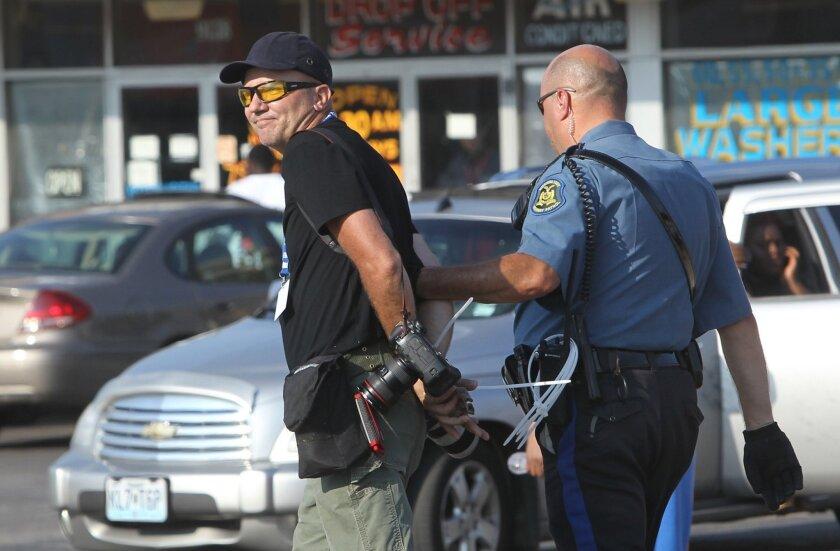 Journalist arrested in Ferguson