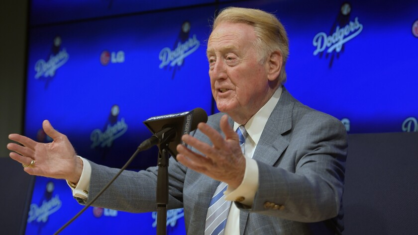 Dodgers announcer Vin Scully speaks during a news conference.