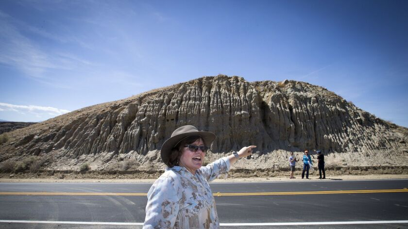 INDIO, CALIF. -- WEDNESDAY, MAY 3, 2017: Seismologist Lucy Jones, center, stands directly on the San