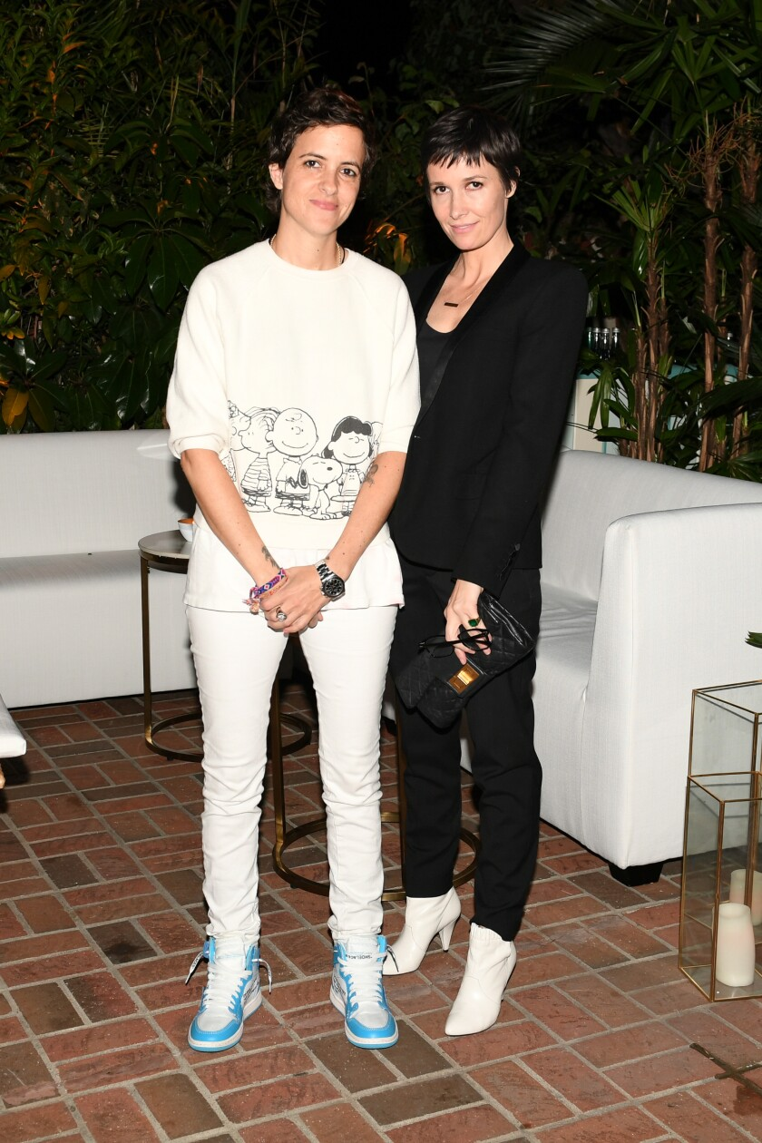DJ Samantha Ronson, left, and Cassandra Grey at the Chanel dinner in West Hollywood.