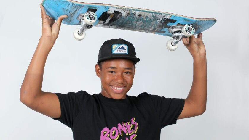 Portrait of Cordano Russell, a 14-year-old competitive skateboarder on tour with the Come Up Tour sponsored by Bones Love Milk, traveling across the state to teach others skateboarding and show off