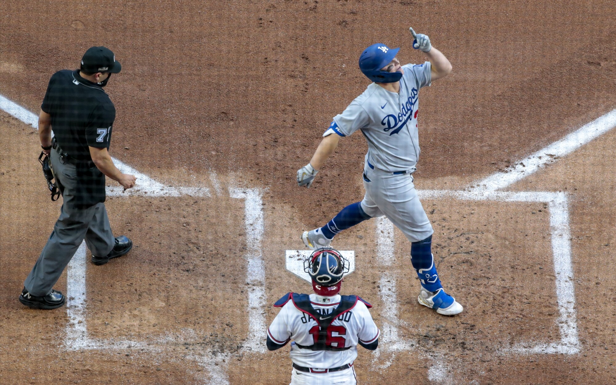 Dodgers left fielder Joc Pederson celebrates as he crosses the plate after hitting a three-run home run in the first inning.
