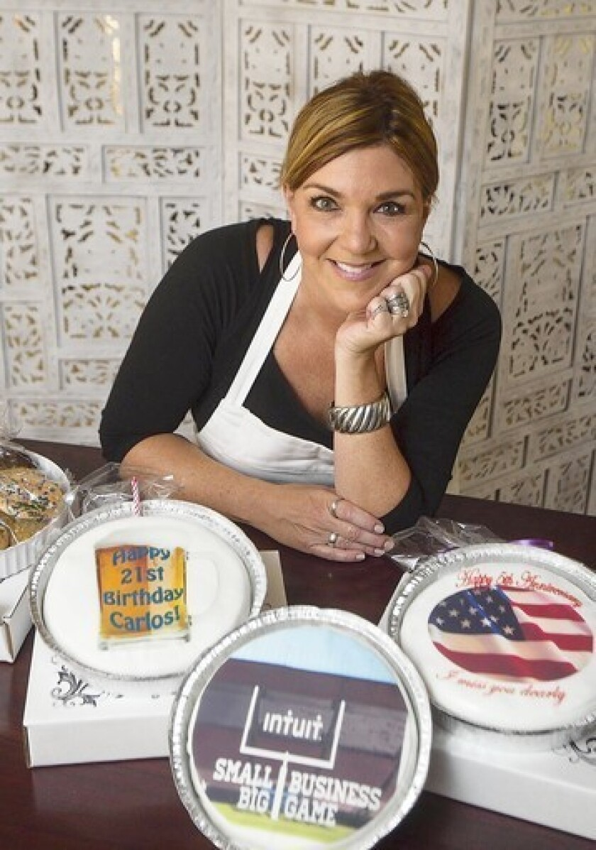 Debora Tsakoumakis is the owner of WireACake.com. Her business is among the top 20 finalists of 15,000 that have applied to win a Super Bowl advertisement from Intuit.