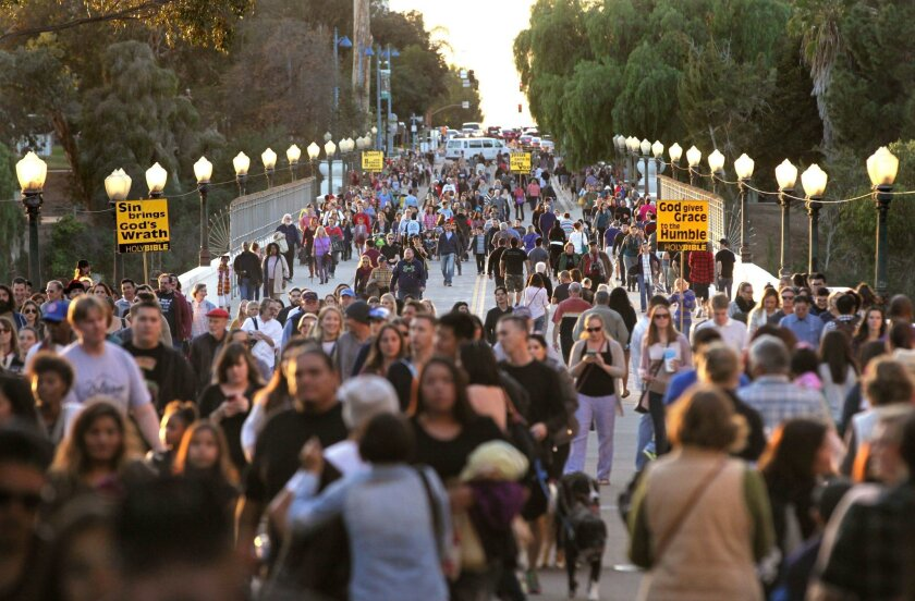 New data released by the California Department of Finance shows San Diego County has the second largest population in the state, after Los Angeles. In this file photo, pedestrian traffic crowds the Laurel Street Bridge at dusk as people stream into Balboa Park for day 2 of December Nights.