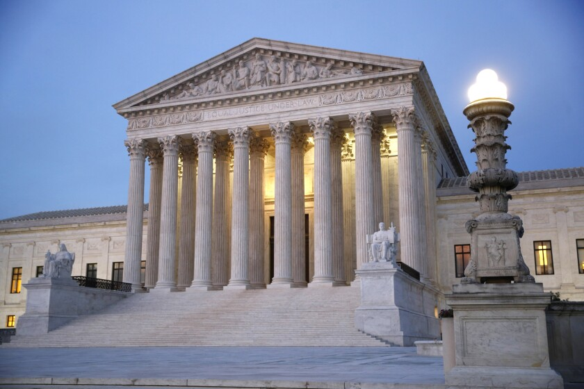 In this May 23, 2019 file photo, the U.S. Supreme Court building at dusk, on Capitol Hill in Washington. (AP Photo/Patrick Semansky)