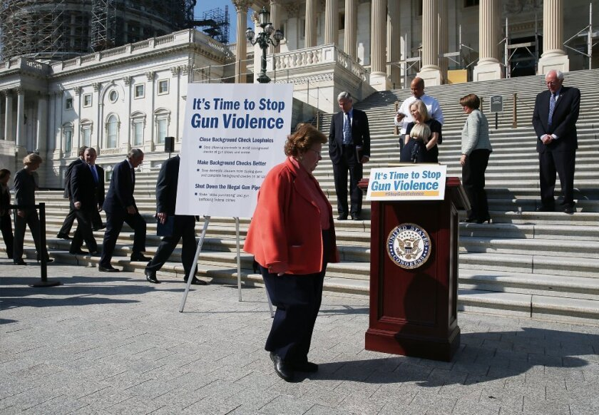 Sen. Barbara Mikulski (D-Md.) joins colleagues at a news conference on gun control at the U.S. Capitol on Oct. 8.