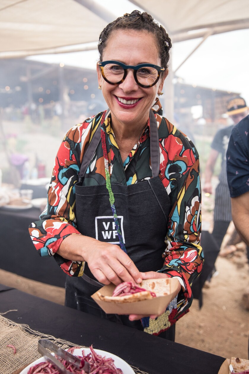 Valle Food & Wine Fest co-founder Nancy Silverton prepares a food dish for a festival-goer at the annual event in Baja's Valle de Guadalupe.