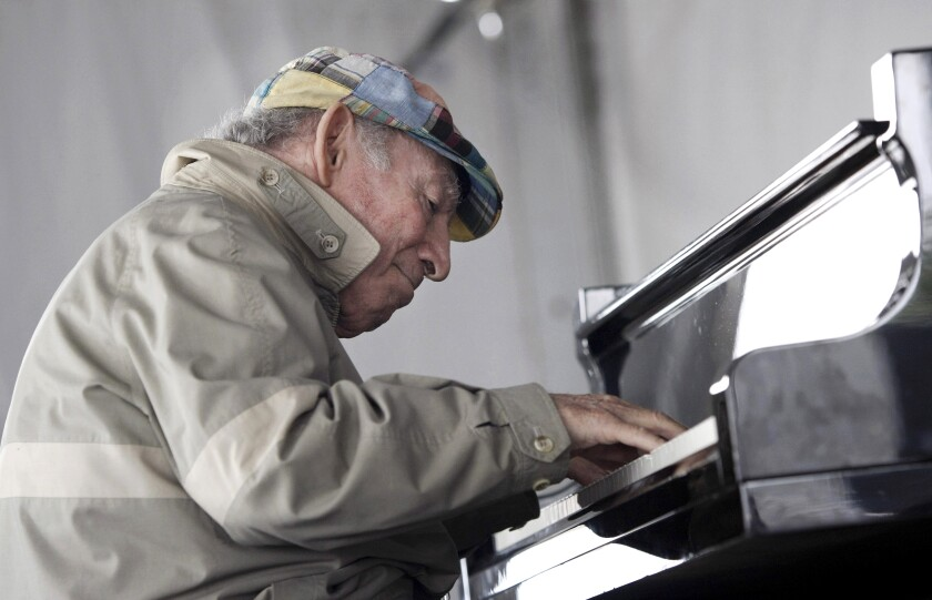 George Wein plays piano