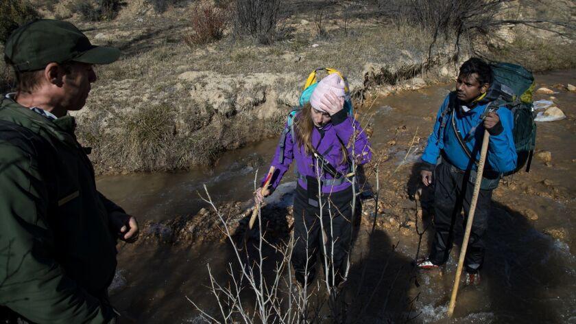 ZION, UTAH - NOVEMBER 11, 2018: National park Ranger Tim Knaus advises hikers Annie Kitchen,34, and