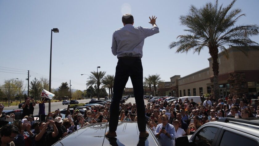 Democratic presidential candidate and former Texas congressman Beto O'Rourke speaks from the roof of