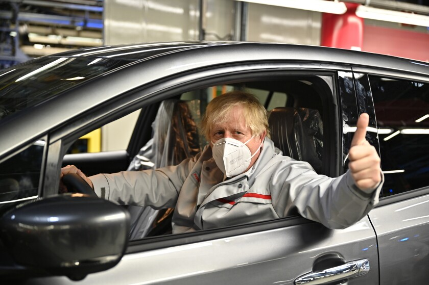 British Prime Minister Boris Johnson visits the Nissan Motor Co. plant, in Sunderland, England, Thursday, July 1, 2021. Japanese carmaker Nissan and two partners announced plans to invest 1 billion ($1.4 billion) pounds to produce a new model of an all-electric vehicle and batteries in northeast England, a major victory for the U.K. government's efforts to attract jobs and investment following the country's departure from the European Union. ( Jeff J Mitchell/Pool Photo via AP)