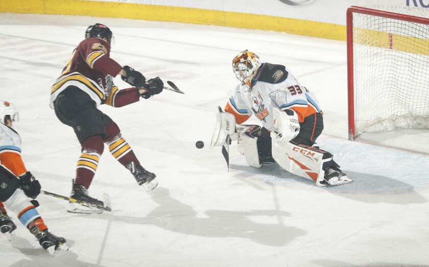 Gulls goalie Kevin Boyle (right) makes a save on Chicago's Stefan Matteau during Game 6.