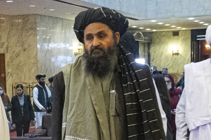 FILE - In this March 18, 2021, file photo, Taliban co-founder Mullah Abdul Ghani Baradar, arrives with other members of the Taliban delegation for an international peace conference in Moscow, Russia. Baradar's biography charts the Taliban's long journey from a pious but brutal Islamic militia to an insurgency that battled the U.S. for two decades, ultimately returning to power through pragmatic diplomacy and military might. His experience also sheds light on the Taliban's complicated relationship with neighboring Pakistan. (AP Photo/Alexander Zemlianichenko, Pool, File)