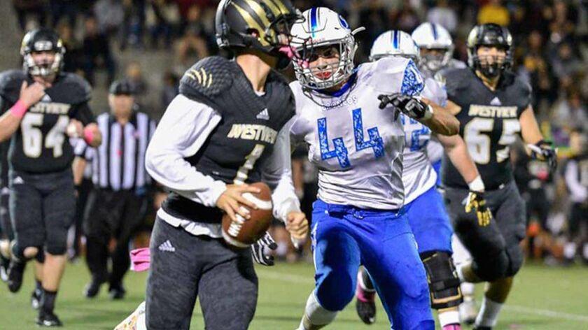 Rancho Bernardo linebacker Adam Burdette pressures Westview quarterback Beau Nelson during Friday ni