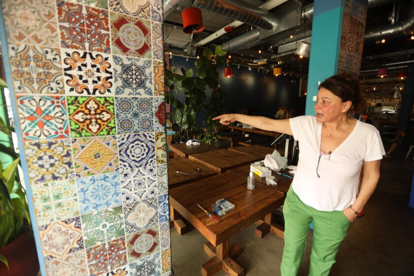 Nicole Chammaa, owner of Sunnin Lebanese Cuisine, stands inside the vandalized restaurant in Santa Monica