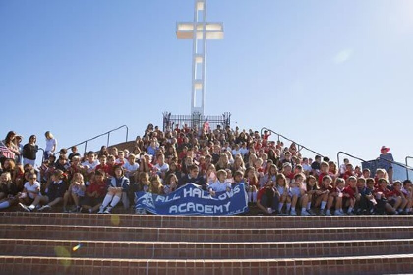 All Hallows Academy students and staff take a group photo at the Mount Soledad Veterans Memorial. There are more than 3,000 plaques honoring veterans — living and deceased, from the Revolutionary War to the current conflicts in the Middle East — at the memorial site. (Courtesy Photos)