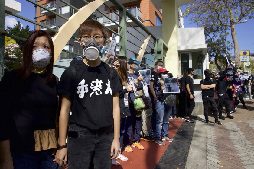 A boy wears a gas mask during a rally to protest against the exposure of children to tear gas by police in Hong Kong, Saturday, Nov. 23, 2019. U.S. President Donald Trump on Friday wouldn't commit to signing bipartisan legislation supporting pro-democracy activists in Hong Kong as he tries to work out a trade deal with China. (AP Photo/Ng Han Guan)