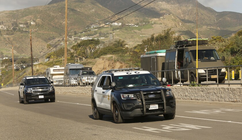 L.A. County sheriff's vehicles during a homeless count in Malibu in 2020.