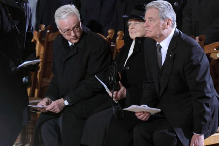 Fritz von Weizsaecker, left, attends the 2015 funeral of his father, former German President Richard von Weizsaecker, in Berlin. He is joined by his mother, Marianne von Weizsaecker, and then-German President Joachim Gauck.