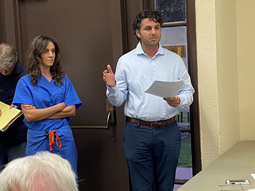 La Jolla Shores residents Engy and Bishoy Said face questions from neighbors about a proposed companion unit, during the La Jolla Shores Permit Review Committee meeting Dec. 16.
