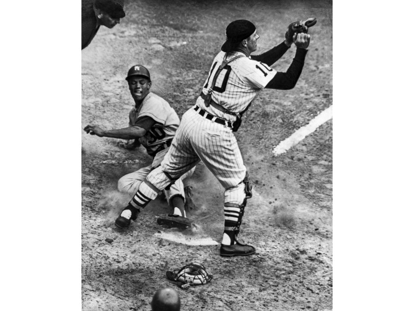 Oct. 8, 1959: Dodger Maury Wills scores from first base on fourth inning double by Johnny Podres. White Sox catcher Sterm Lollar waits for ball. The Dodgers scored six runs in inning for 9-3 victory in Game 6 of the 1959 World Series.