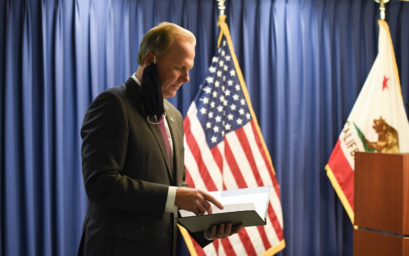 San Diego Mayor Kevin Faulconer looks at prepared remarks in June.
