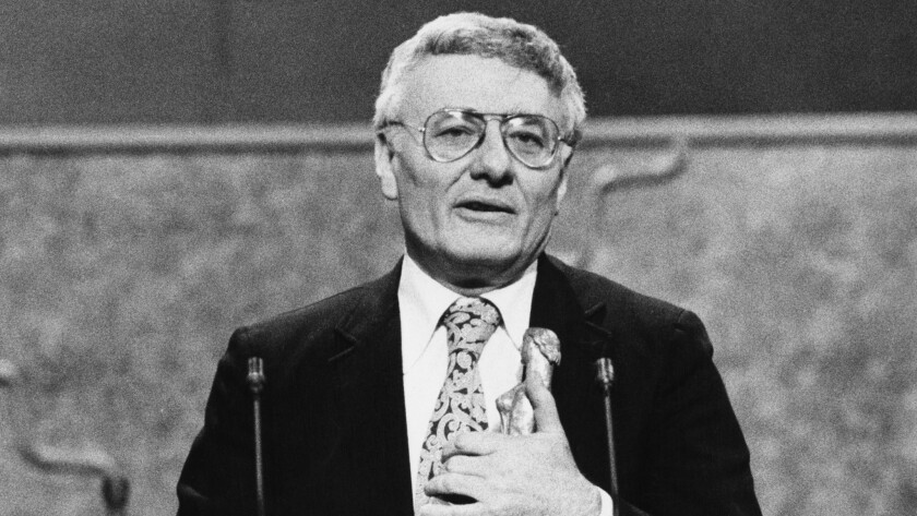 "English playwright Peter Shaffer, pictured in 1980 accepting the best play award for ""Amadeus"" at the Evening Standard Drama Awards in London."