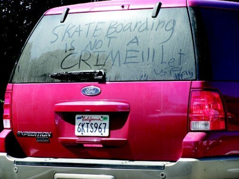 a message on the back of a car seen in the Village conveys what many Windemere homeowners have been saying since their association board banned skateboards on the community's streets. Photo: Susan DeMaggio