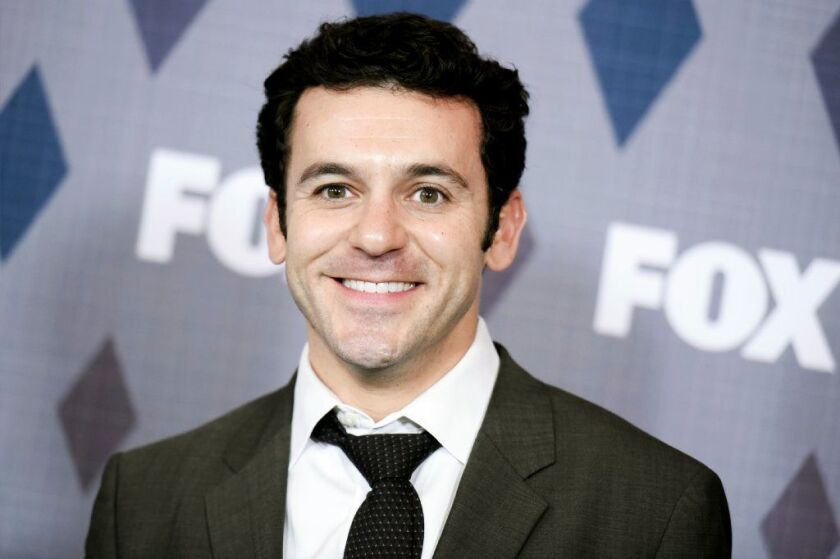 "Actor Fred Savage attends a Fox event in Pasadena, Calif., on Jan. 15, 2016. A court ruling entered Sept. 5, 2018, in Los Angeles rejected six of seven charges filed against Savage by a costumer who claims she was harassed and struck on the set of the Fox sitcom ""The Grinder."""