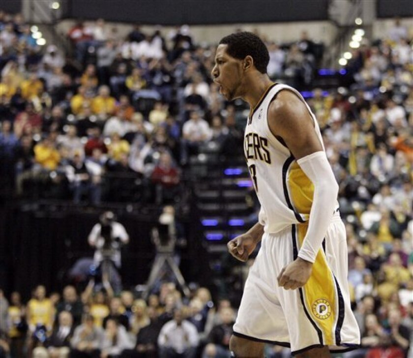 Indiana Pacers forward Danny Granger reacts after guard T.J. Ford hit a shot late in the fourth quarter of an NBA basketball game against the Orlando Magic in Indianapolis, Friday, Feb. 6, 2009. Indiana won 107-102. (AP Photo/Darron Cummings)