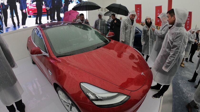 A Tesla Model 3 on display during a groundbreaking ceremony for a Tesla factory in Shanghai on Jan. 7.